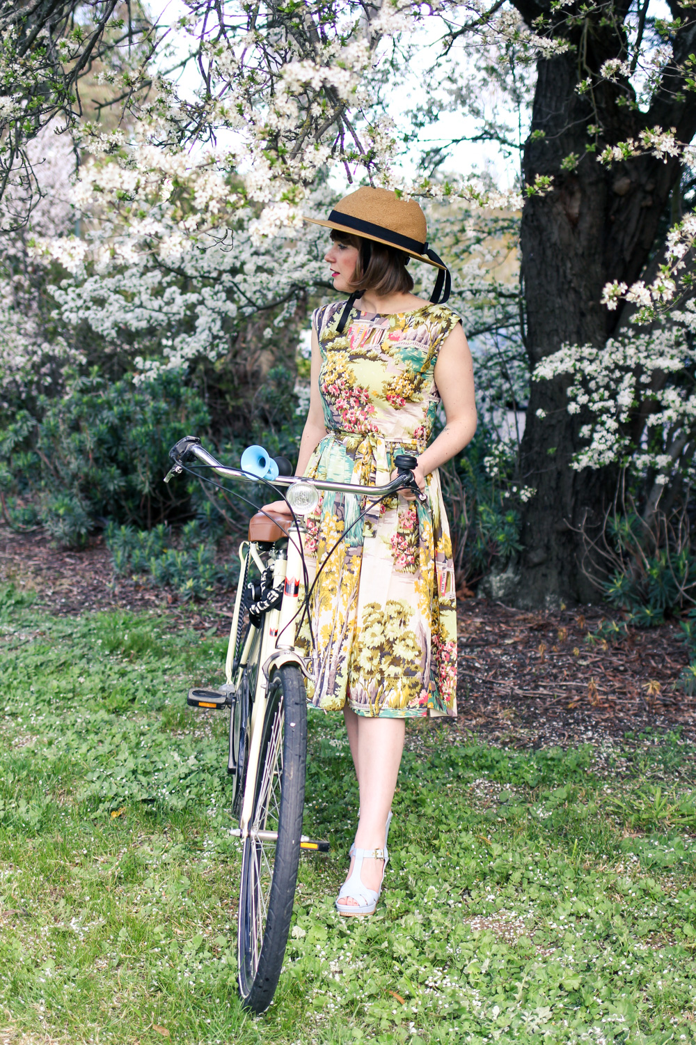 @findingfemme does bike style in Yakkay helmet and lazybones dress on her bike