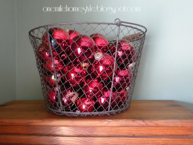 Christmas ornaments in a wire basket