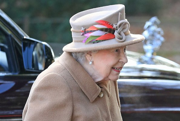 Queen Elizabeth and Prince Andrew attended Sunday Service. The Queen wore a light brown coat and hat decorated with feathers