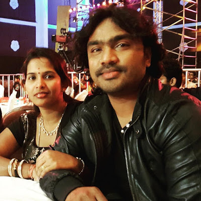 Arjun janya and his wife