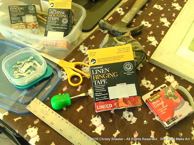 Framing tools and supplies laid out, ready to use as I frame my watercolor paintings.