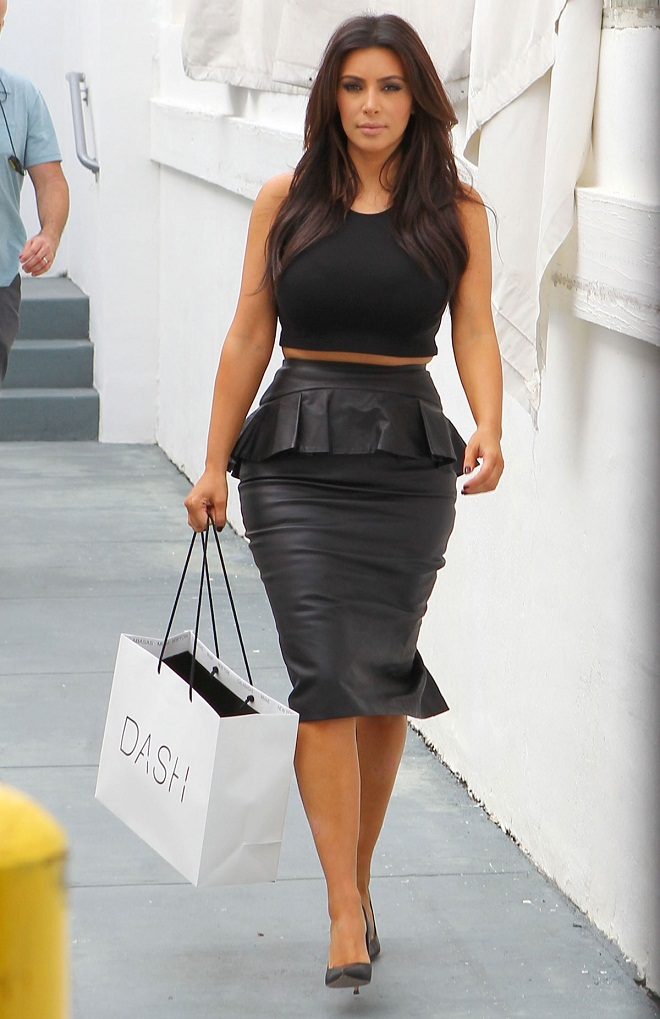 600527b67bd Kim Kardashian shows muffin top in a too tight peplum skirt in Miami