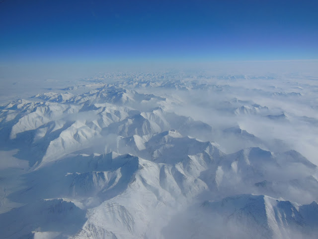 Alaskan mountains seen from high altitude aboard the NASA P-3B during the IceBridge transit flight from Thule to Fairbanks on March 21, 2013.  NASA's Operation IceBridge is an airborne science mission to study Earth's polar ice.  Image Credit: NASA/Goddard/Christy Hansen