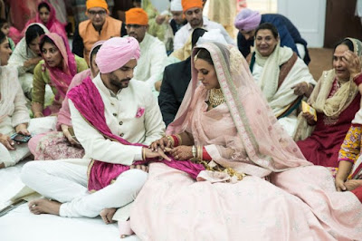 neha-and-angad-exchange-rings-at-their-anand-karaj-ceremony-in-delhi