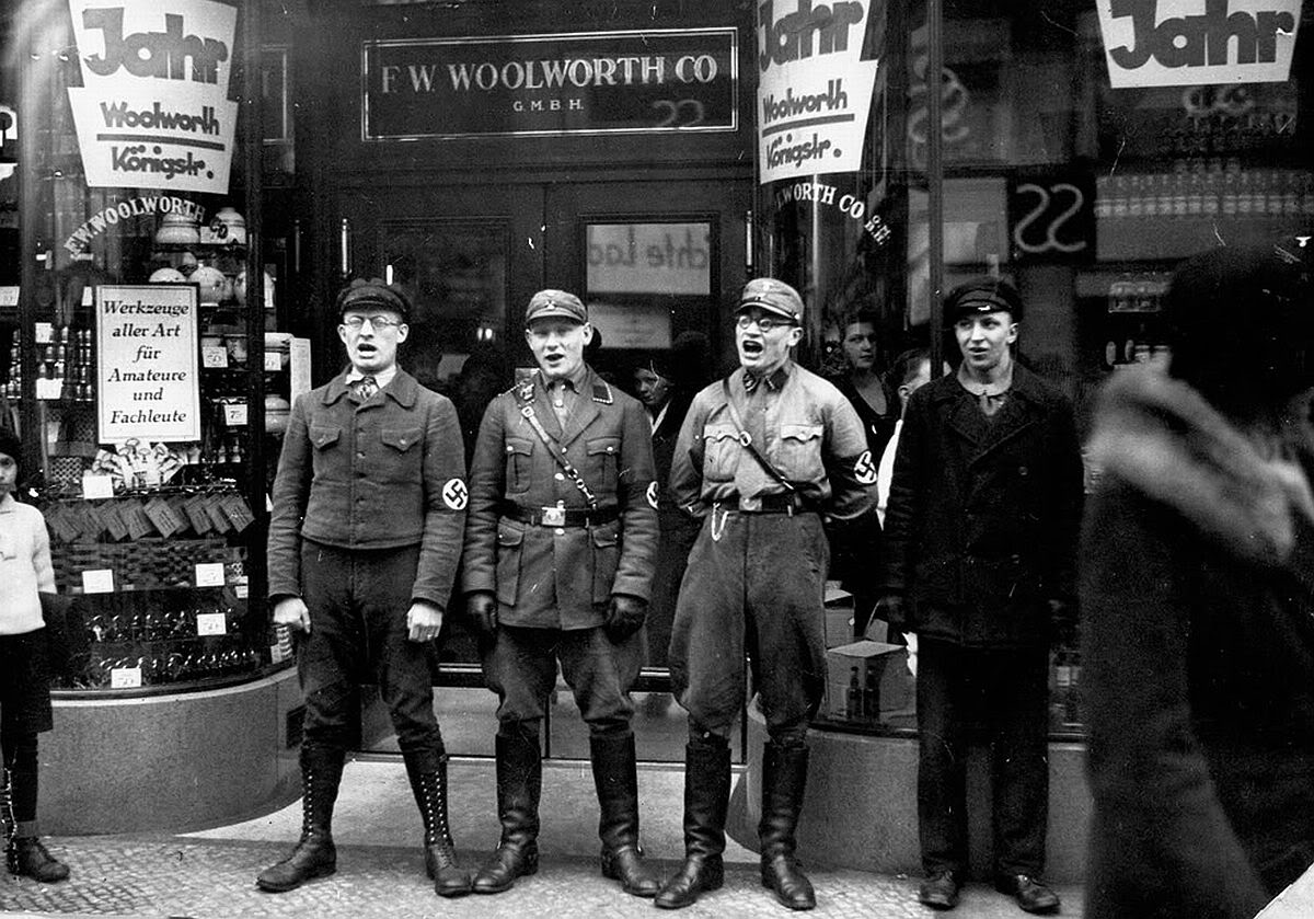 Nazis+singing+to+encourage+a+boycott+of+the+allegedly+Jewish-founded+Woolworths,+1933.jpg