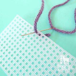 Shows how to do an overcast stitch on plastic canvas