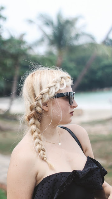 Fashion and Travel Blogger GlobalFashionGal (Brianna Degaston) with a french dutch side braid and Prada sunglasses in Bintan Island, Indonesia.