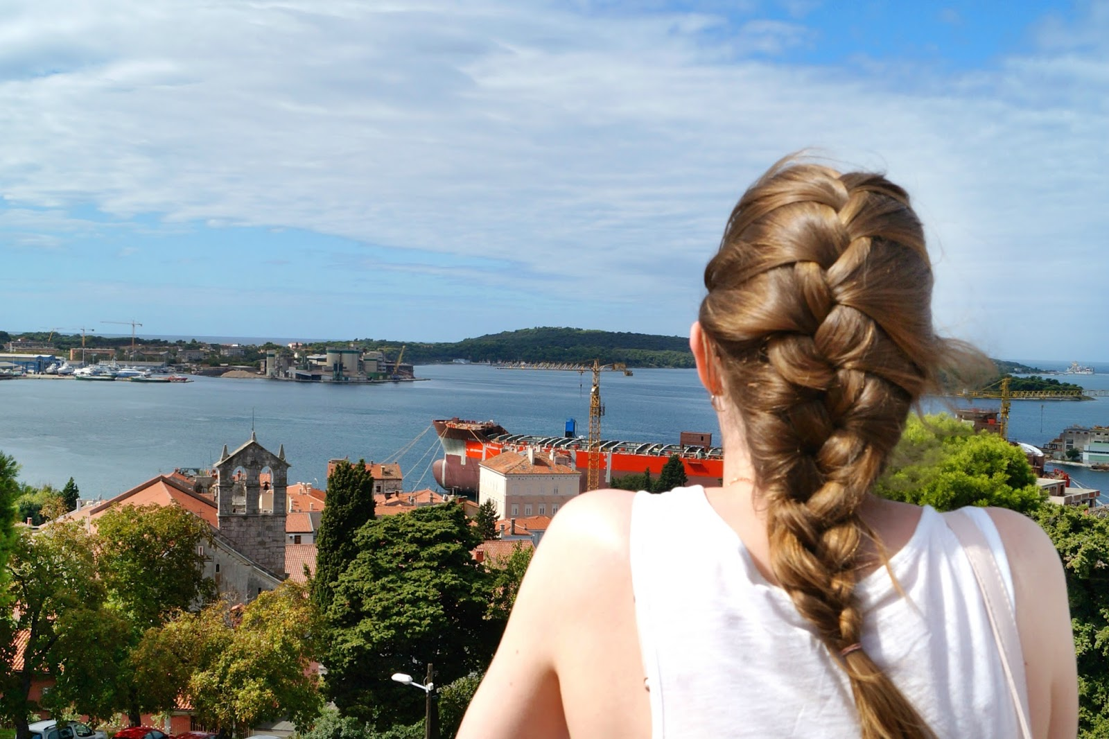 Girl Overlooking Sea And City of Pula