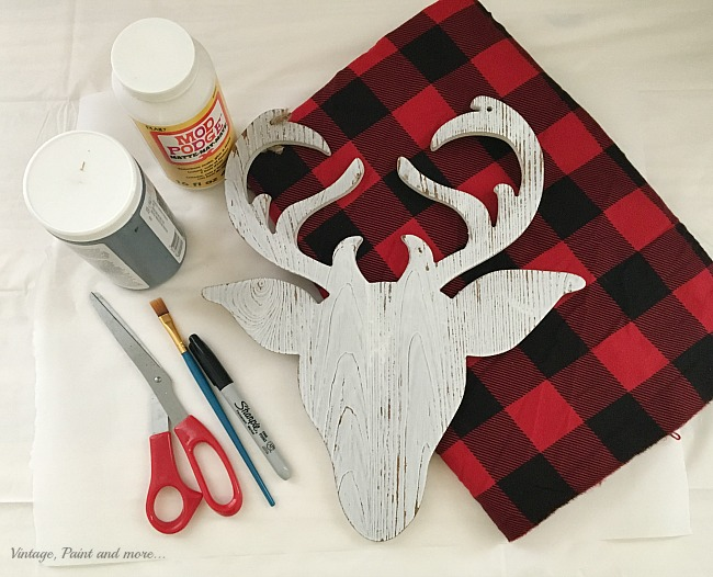 Vintage, Paint and more... supplies needed to make a yarn wreath with a decoupaged buffalo plaid deer head for a Farmhouse Christmas Wreath