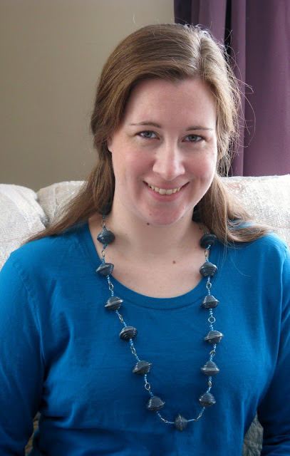 Rachel wearing a necklace made at Mercy House