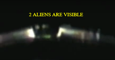 Two Aliens can be seen at the window of the UFO.