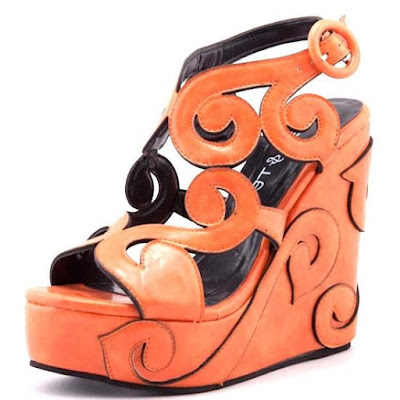 http://glamourchic.tictail.com/product/ava-orange-wedges-sandals