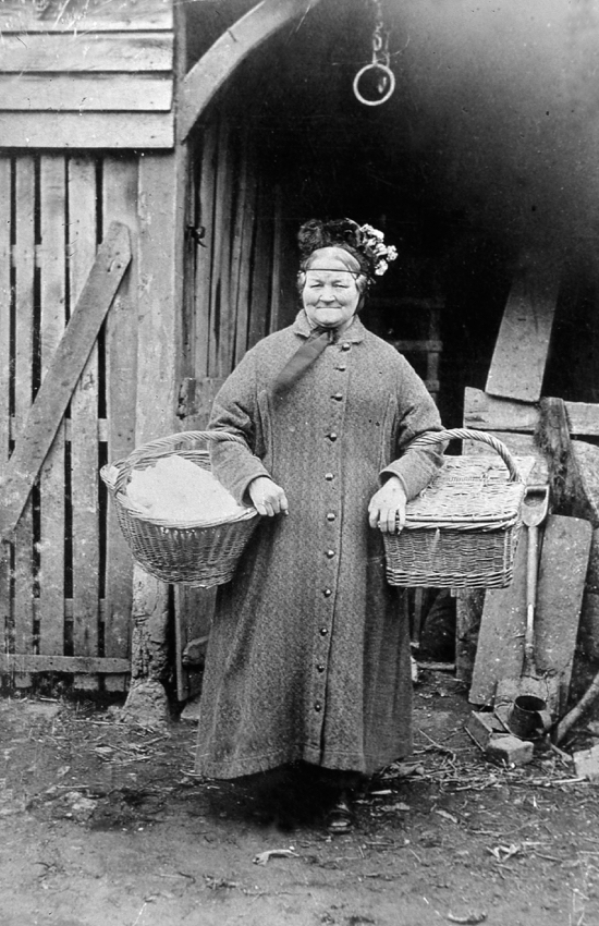 Photograph of John Chuck's wife on her bread round. The bakery was opposite the Hope & Anchor in the 1900s