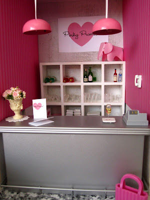 Modern one-twelfth scale miniature bar scene in shades of pink, white and grey.