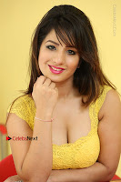 Cute Telugu Actress Shunaya Solanki High Definition Spicy Pos in Yellow Top and Skirt  0591.JPG
