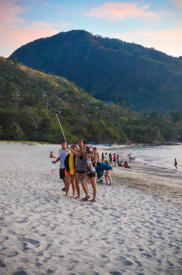 A group of friends enjoying the beach at Puerto Galera