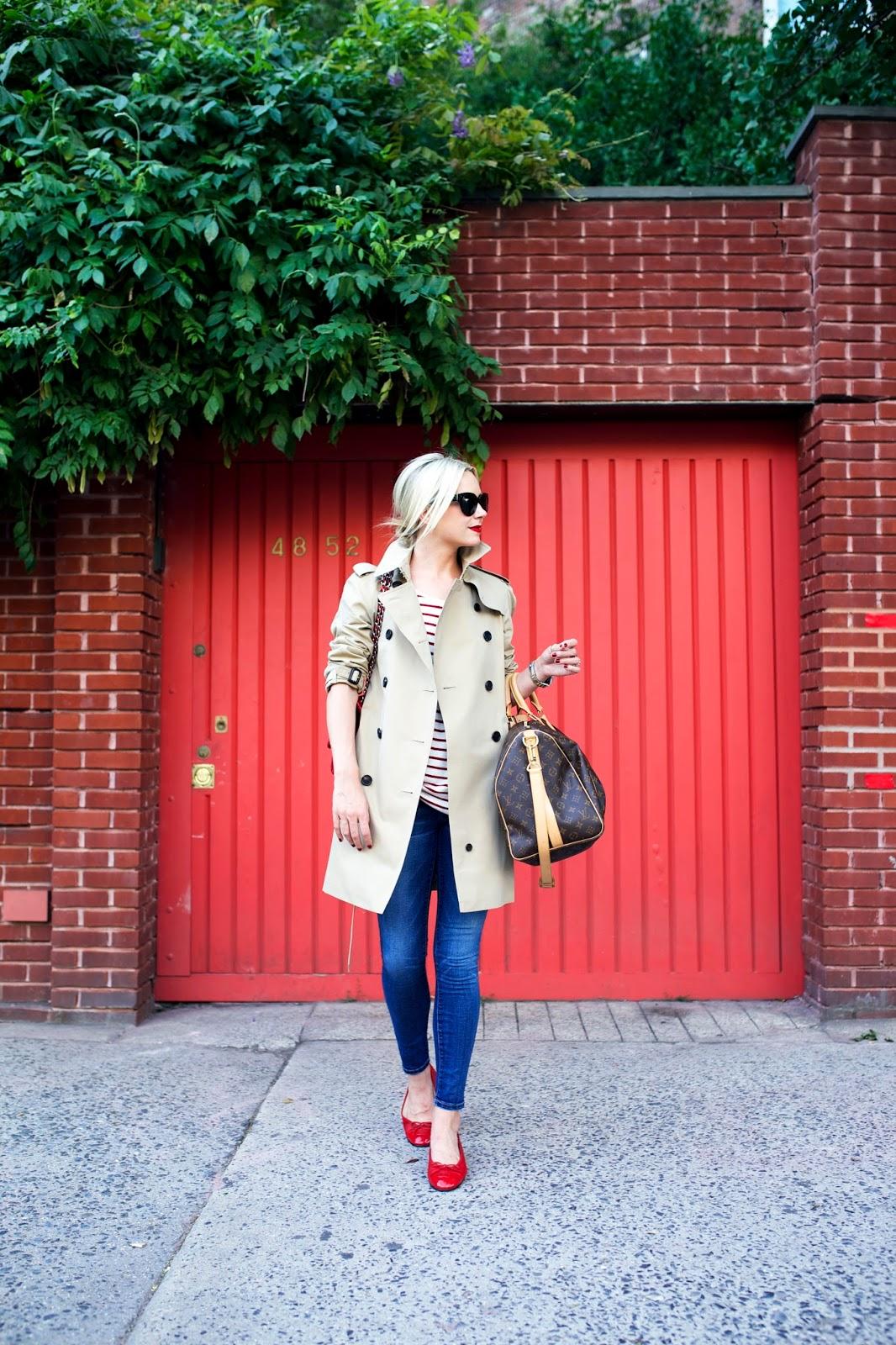 Lady wearing thigh length tan jacket