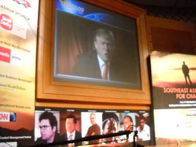 Mr Donald Trump giving speechs on YES 2009 Summit in Kuala Lumpur . I took the photo of him on the big screen during the summit.   Photo Asep Haryono