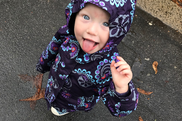 Little in the rain with her waterproof hood up and tongue out to catch rain drops
