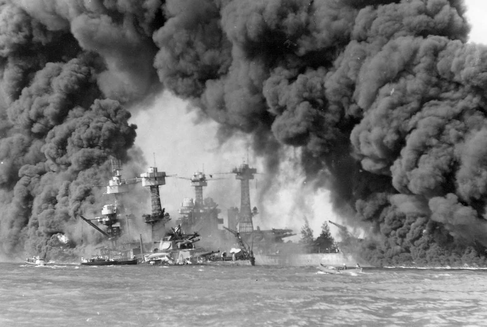 The battleships West Virginia and Tennessee burning after the Japanese attack on Pearl Harbor, on December 7, 1941.
