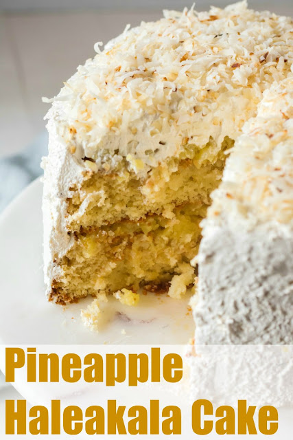 This cake is amazing! It is LOADED with pineapple and then coated in a big white cloud of frosting. Add a little coconut to drive the taste of the tropics home!