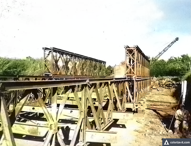 Bailey bridge under construction in Cuenca, Batangas in 1945.  Image source:  United States National Archives.