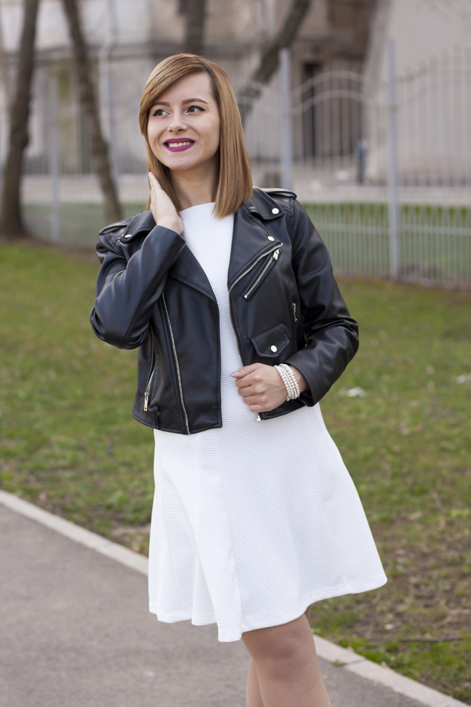 black leather jacket and white dress
