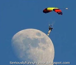 man-parachute-walks-on-moon