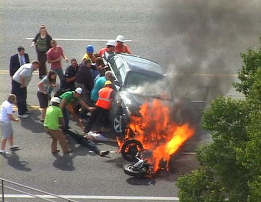 When these bystanders joined forces to literally lift a car off of a trapped motorcyclist.