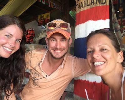 Photo of Ellis having cocktails with Reneé and Sebastian on Koh Muk