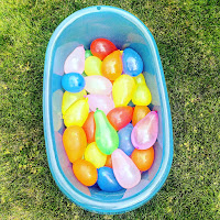 water balloons in a bathtub outside