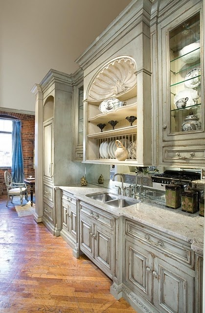 This grand kitchen is a french style dream with gorgeous crown molding and accent lighting