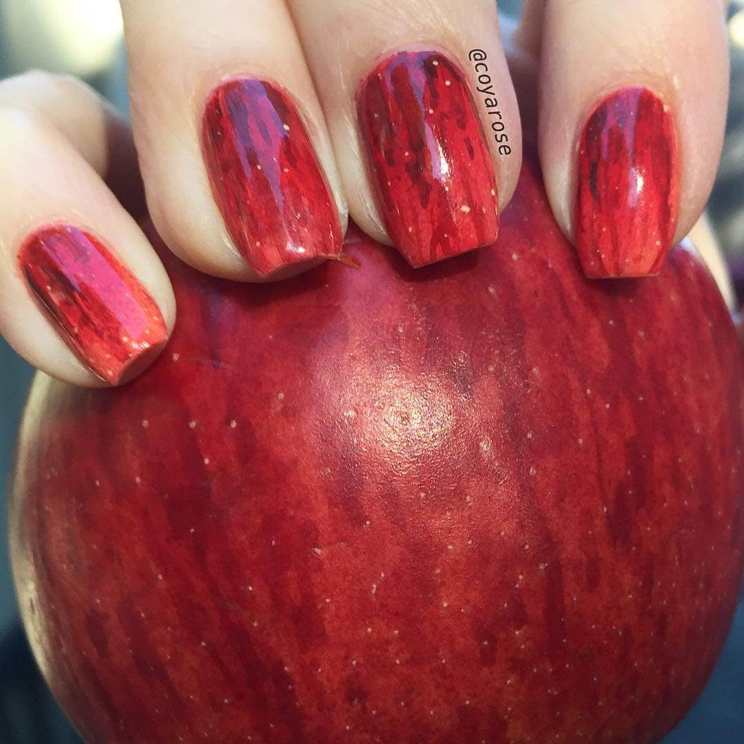 05-Red-delicious-apple-design-Nicoya-Grobman-Free-Hand-Nail-Art-Designs-www-designstack-co