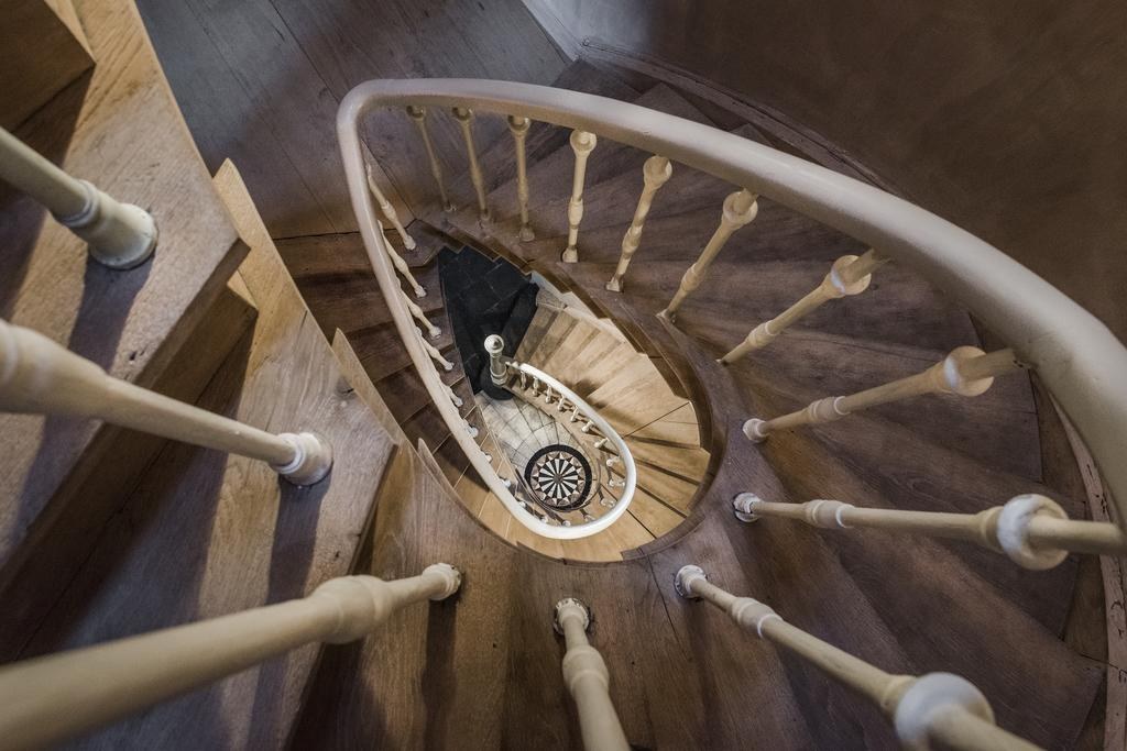 Breathtaking winding staircase in White Rooms in Bruges, Belgium - found on Hello Lovely Studio