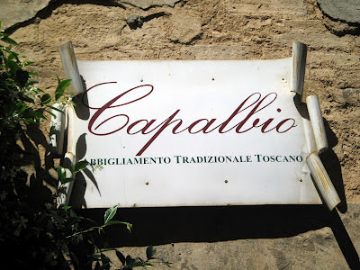 Italian signs! In this case the one of the Capalbio store in Montalcino