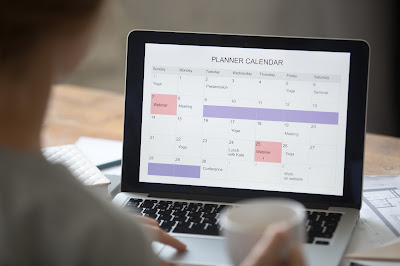 laptop with planner calendar screen