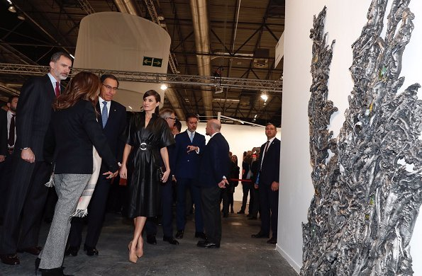 Queen Letizia wore &Other Stories Belted Leather Midi Dress, Prada nude pumps and carried Uterque clutch bag