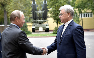 Vladimir Putin at the Almaz-Antey Air and Space Defense Corporation with Director General Yan Novikov.