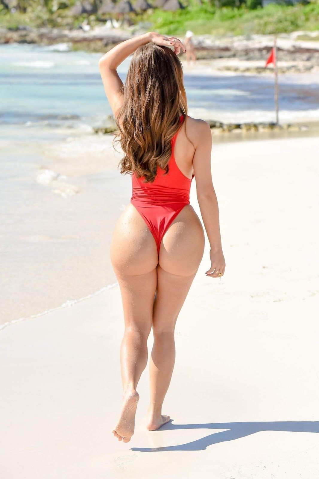 Demi Rose looks red hot in a one piece thonged swimsuit in Mexico