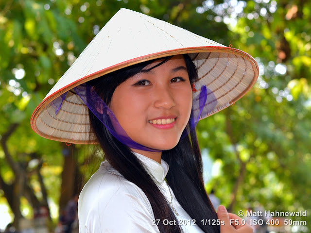 Asian conical hat, conical straw hat, Vietnamese style conical hat, nón lá, sedge hat, rice hat, paddy hat, young Vietnamese woman, portrait, headshot, Vietnam, Hanoi