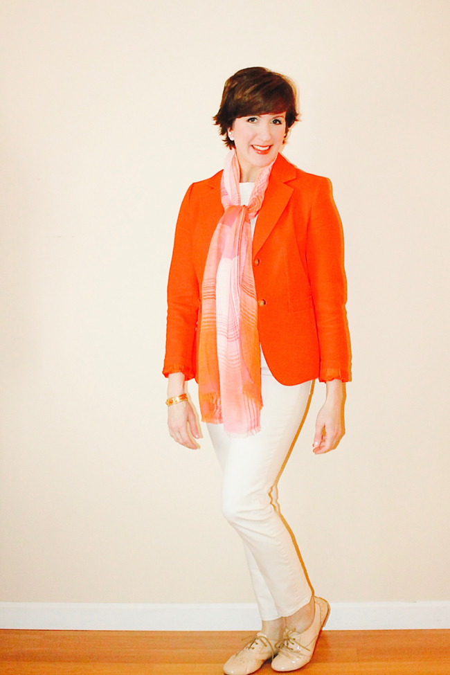 Fashion blogger modeling orange jacket