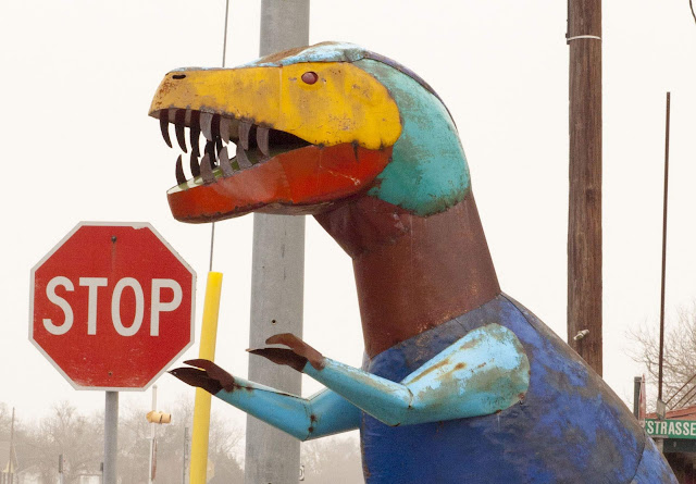 Painted metal T-Rex dinosaur near Weikel's Bakery between Houston and Austin, Texas