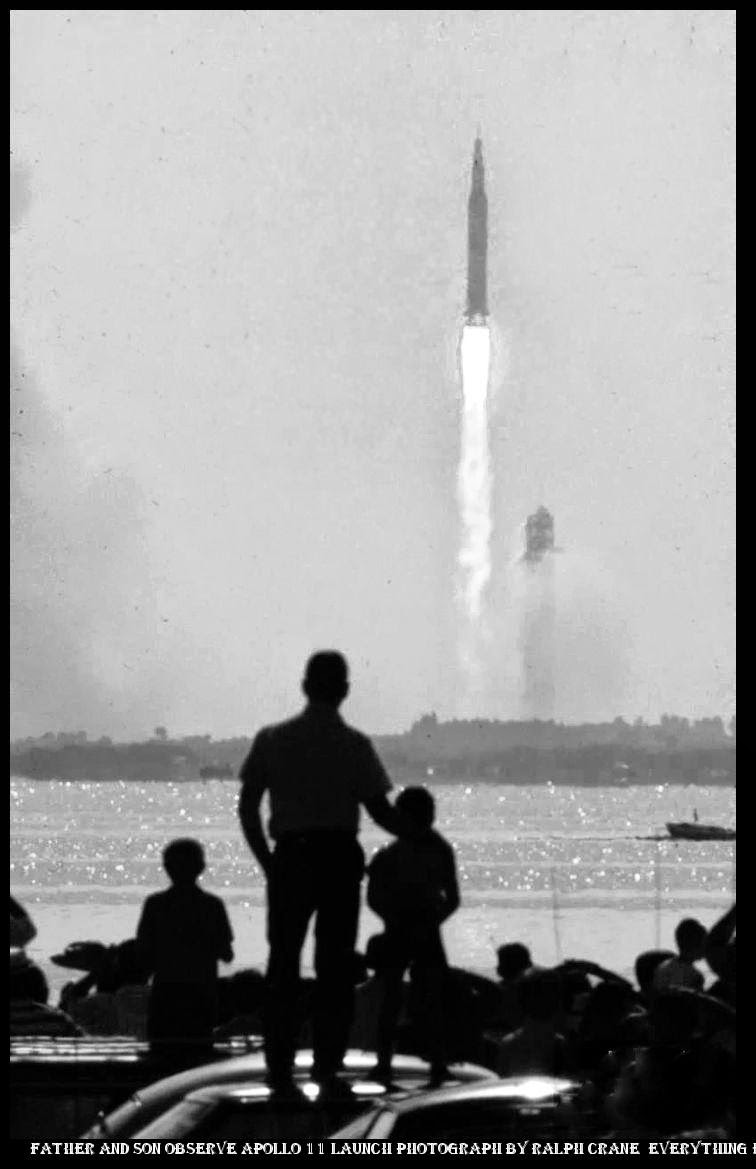 13ec3cb1687287 ... asics 2000 review Father and son observe Apollo 11 launch photograph by  Ralph Crane Everything Else