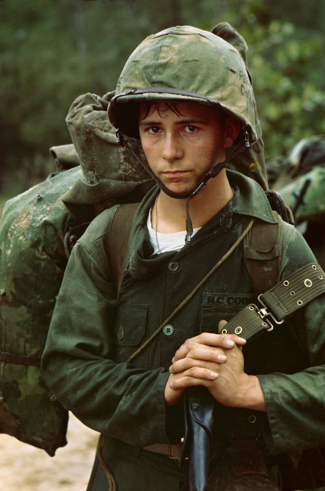 A young private waits on the beach during the Marine landing at Da Nang, Vietnam, August 3 1965