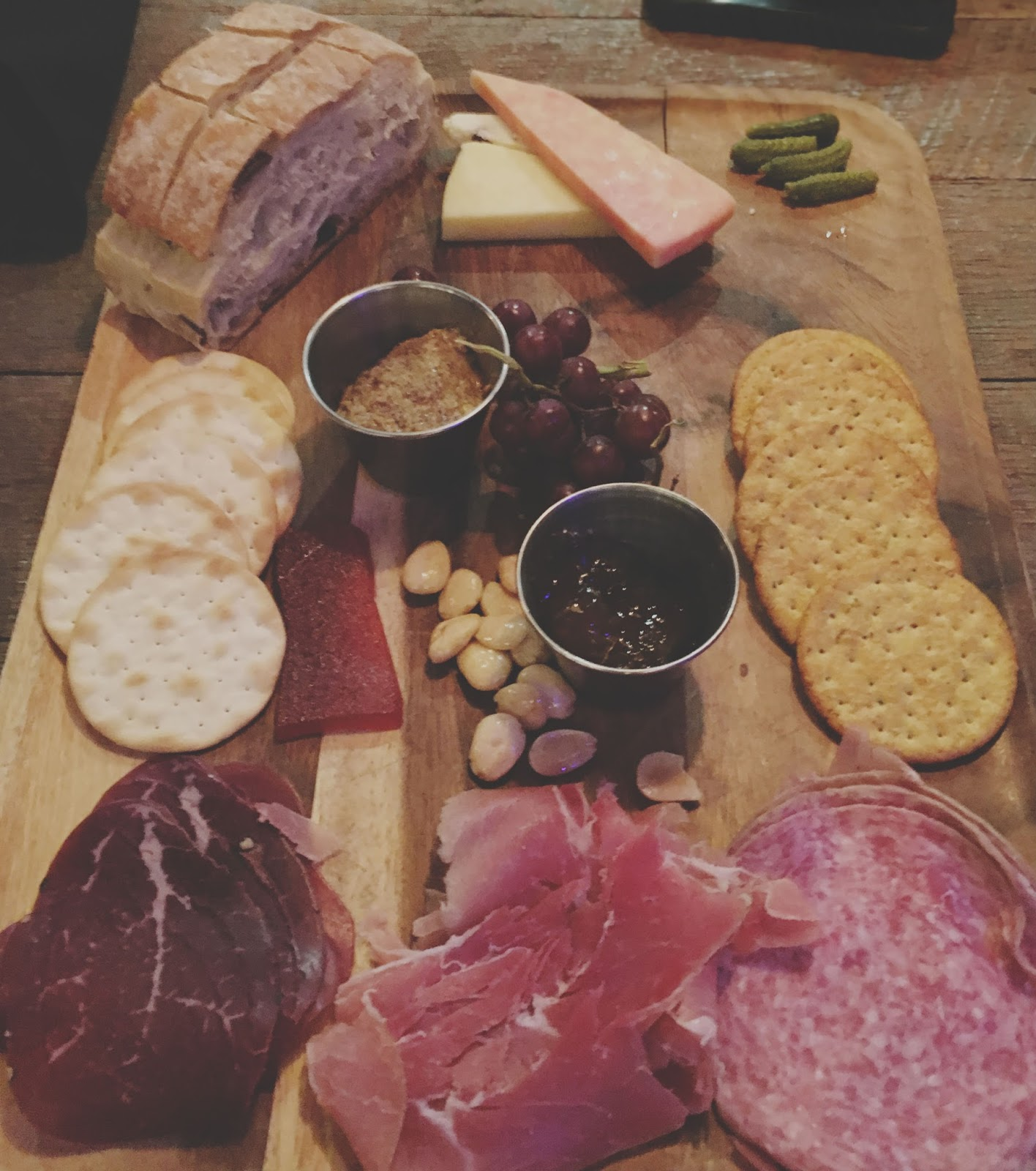 meat and cheese plate at Local Pour, a restaurant in Houston, Texas