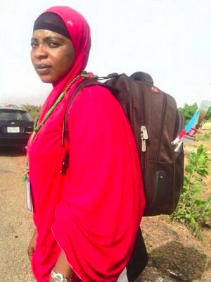 woman trekking for buhari