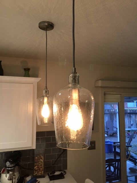 renovated kitchen, gray and white, pendant lights