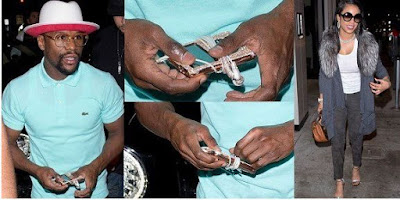 Floyd Mayweather spotted holding his diamond encrusted iPod reportedly worth $1m, the headphones alone cost $50k