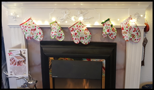 Stuffed mittens round the fireplace for Christmas