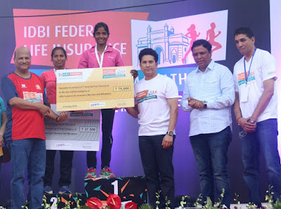 Pic 1: (L-R) - Kishor Kharat, MD & CEO, IDBI Bank, Sachin Tendulkar, Face of the IDBI Federal Life Insurance Mumbai Half Marathon, Ashish Shelar, MLA & President, Bharatiya Janata Party, Vighnesh Shahane, CEO, IDBI Federal Life Insurance along with the Elite Women winners of the Half Marathon.